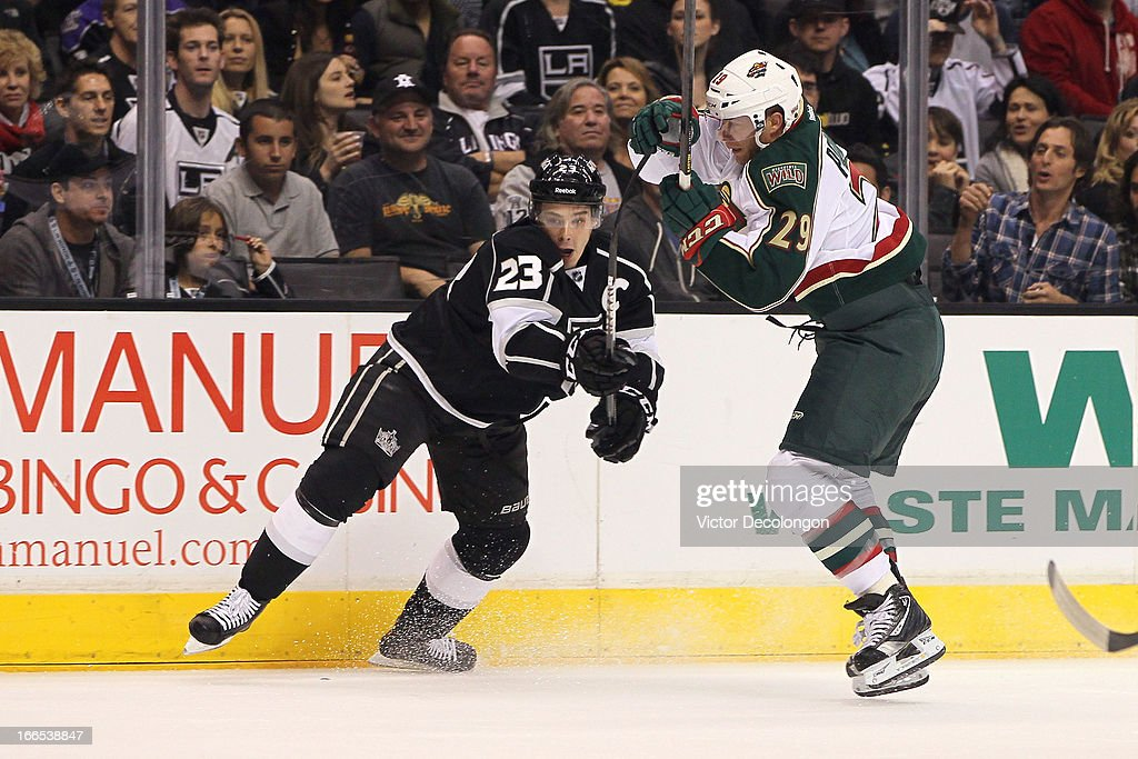 Dustin Brown #23 of the Los Angeles King checks <a gi-track='captionPersonalityLinkClicked' href=/galleries/search?phrase=Jason+Pominville&family=editorial&specificpeople=570525 ng-click='$event.stopPropagation()'>Jason Pominville</a> #29 of the Minnesota Wild during the NHL game at Staples Center on April 4, 2013 in Los Angeles, California. The Kings defeated the Wild 3-0.