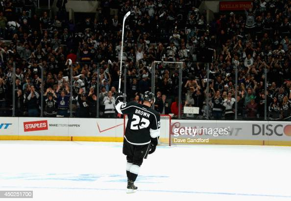 Dustin Brown of the Los Angeles Kings acknowledges the crowd after his overtime goal to defeat the New York Rangers 54 in Game Two of the 2014...