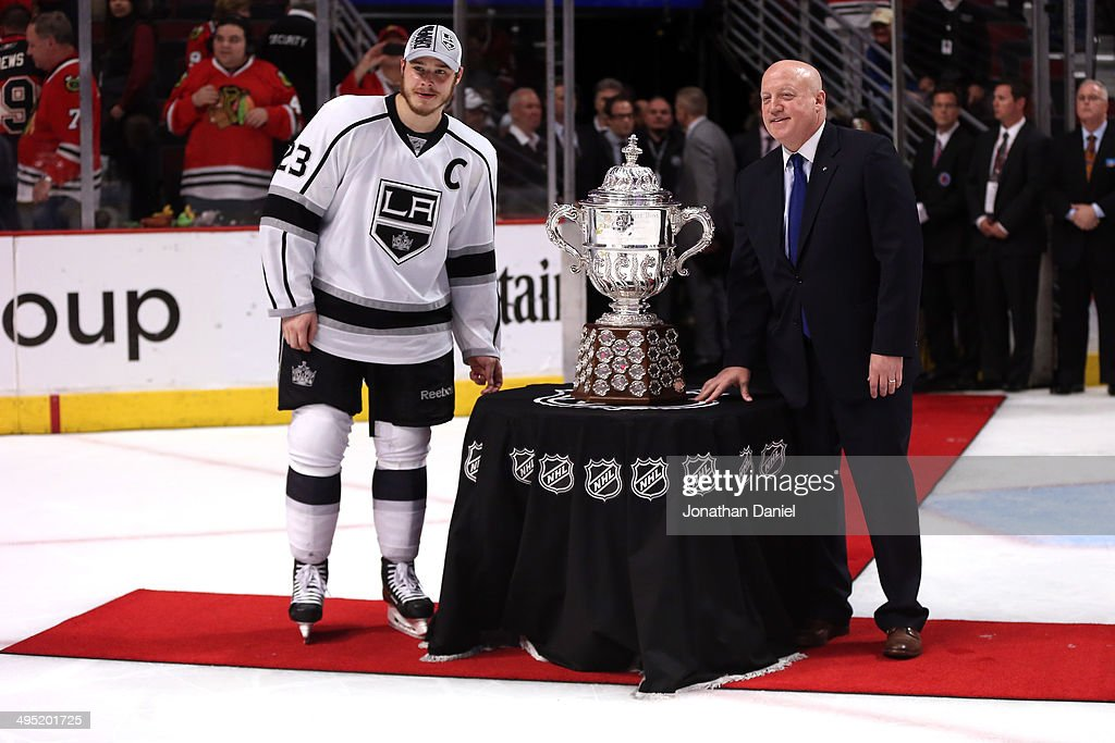 Dustin Brown #23 of the Los Angeles Kings and Deputy commissioner Bill Daly pose with The Clarence S. Campbell Bowl after defeating the Chicago Blackhawks 5 to 4 in overtime in Game Seven to win the Western Conference Final in the 2014 Stanley Cup Playoffs at United Center on June 1, 2014 in Chicago, Illinois.