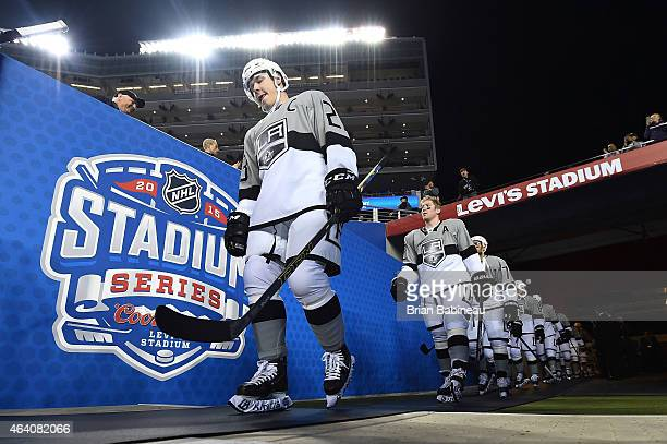 Dustin Brown of the Los Angeles Kings and his teammates walk to the ice surface for warmup prior to the 2015 Coors Light NHL Stadium Series game...