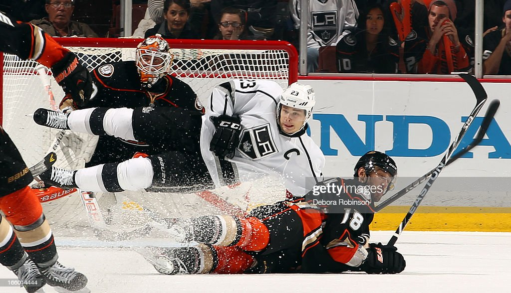 Dustin Brown #23 of the Los Angeles Kings and <a gi-track='captionPersonalityLinkClicked' href=/galleries/search?phrase=Radek+Dvorak&family=editorial&specificpeople=202867 ng-click='$event.stopPropagation()'>Radek Dvorak</a> #18 of the Anaheim Ducks fall to the ice during the game on April 7, 2013 at Honda Center in Anaheim, California.