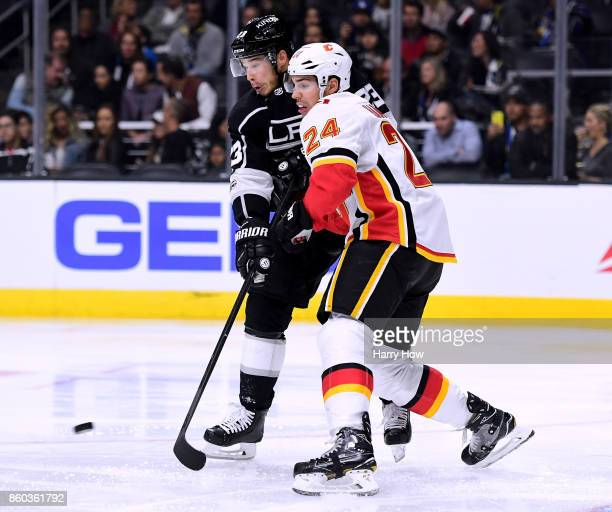 Dustin Brown of the Los Angeles Kings attempts a deflection as he is covered by Travis Hamonic of the Calgary Flames during the second period at...