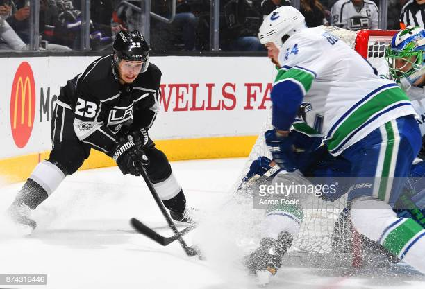 Dustin Brown of the Los Angeles Kings battles for the puck against Erik Gudbranson of the Vancouver Canucks during the game on November 14 2017 at...