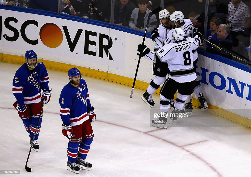 Dustin Brown #23 of the Los Angeles Kings celebrates his goal on Henrik Lundqvist #30 of the New York Rangers with Anze Kopitar #11 and Drew Doughty #8 of the Los Angeles Kings during the second period of Game Four of the 2014 NHL Stanley Cup Final at Madison Square Garden on June 11, 2014 in New York, New York.