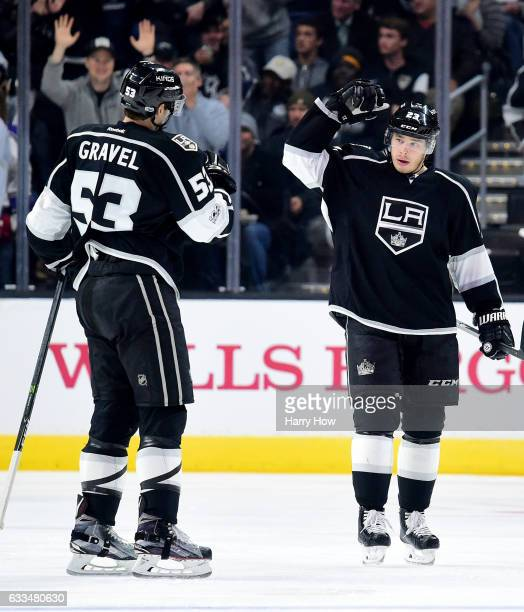 Dustin Brown of the Los Angeles Kings celebrates his goal with Kevin Gravel to take a 40 lead over the Colorado Avalanche during the third period at...