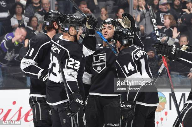 Dustin Brown of the Los Angeles Kings celebrates with Andy Andreoff and Michael Cammalleri after scoring a goal against the San Jose Sharks at...
