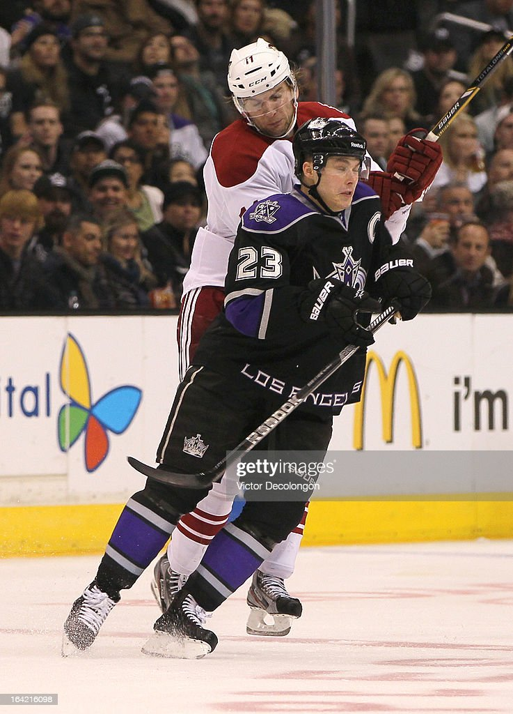Dustin Brown #23 of the Los Angeles Kings checks <a gi-track='captionPersonalityLinkClicked' href=/galleries/search?phrase=Martin+Hanzal&family=editorial&specificpeople=2109469 ng-click='$event.stopPropagation()'>Martin Hanzal</a> #11 of the Phoenix Coyotes at center ice during the NHL game at Staples Center on March 18, 2013 in Los Angeles, California. The Kings defeated the Coyotes 4-0.
