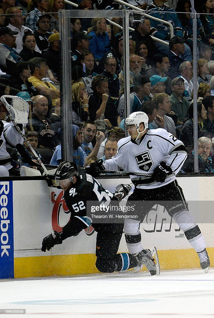 Dustin Brown #23 of the Los Angeles Kings checks Matt Irwin #52 of the San Jose Sharks into the boards in the third period in Game Three of the Western Conference Semifinals during the 2013 NHL Stanley Cup Playoffs at HP Pavilion on May 18, 2013 in San Jose, California. The Sharks won the game in overtime 2-1.