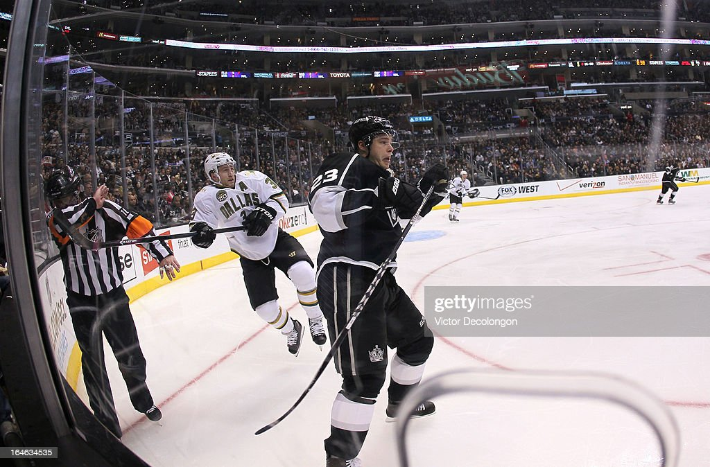 Dustin Brown #23 of the Los Angeles Kings checks <a gi-track='captionPersonalityLinkClicked' href=/galleries/search?phrase=Stephane+Robidas&family=editorial&specificpeople=206166 ng-click='$event.stopPropagation()'>Stephane Robidas</a> #3 of the Dallas Stars in the second period during the NHL game at Staples Center on March 21, 2013 in Los Angeles, California. The Stars defeated the Kings 2-0.