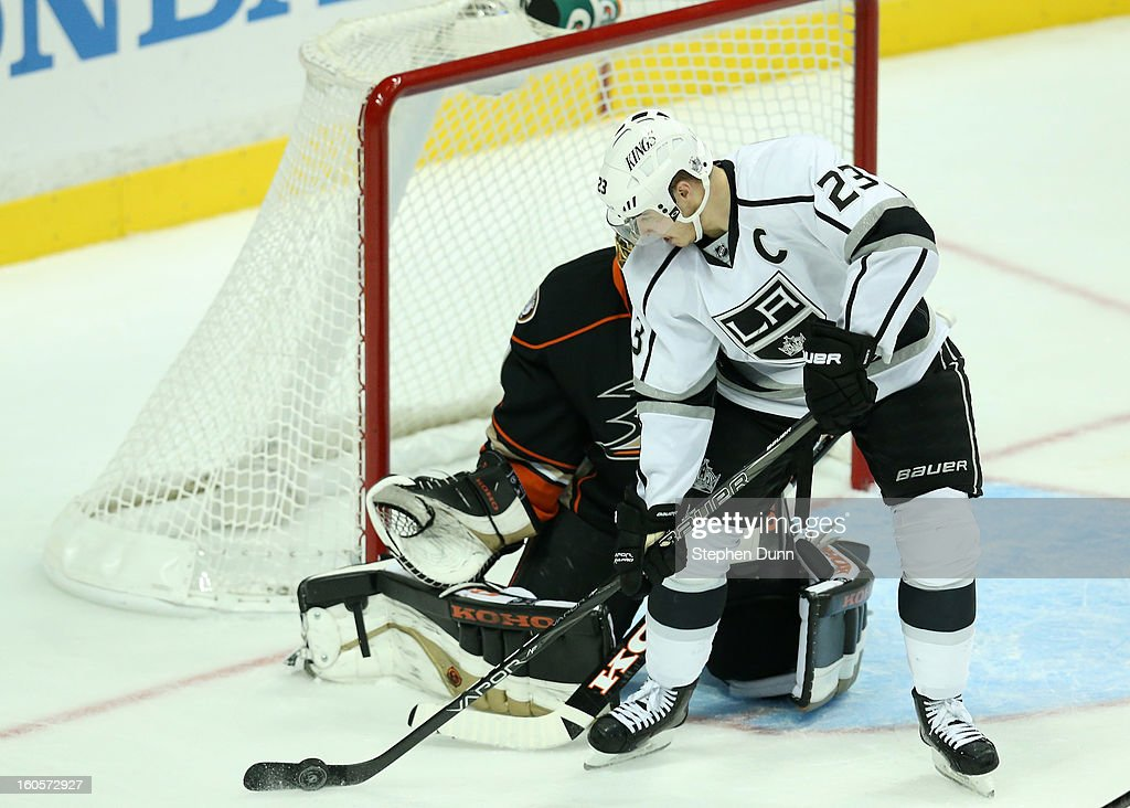 Dustin Brown #23 of the Los Angeles Kings controls the puck in front of goalie <a gi-track='captionPersonalityLinkClicked' href=/galleries/search?phrase=Jonas+Hiller&family=editorial&specificpeople=743364 ng-click='$event.stopPropagation()'>Jonas Hiller</a> #1 of the Anaheim Ducks at Honda Center on February 2, 2013 in Anaheim, California. The Ducks won 7-4.