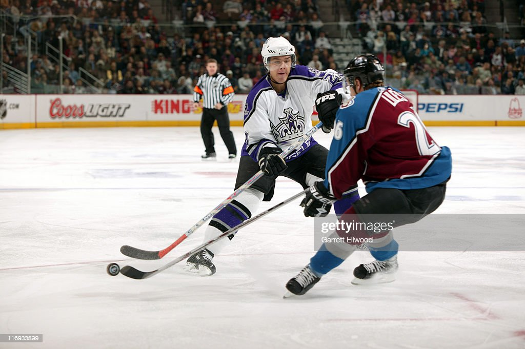 Dustin Brown #23 of the Los Angeles Kings fights for the puck against <a gi-track='captionPersonalityLinkClicked' href=/galleries/search?phrase=John-Michael+Liles&family=editorial&specificpeople=206866 ng-click='$event.stopPropagation()'>John-Michael Liles</a> #26 of the Colorado Avalanche during the game on October 19, 2005 at Pepsi Center in Denver, Colorado.