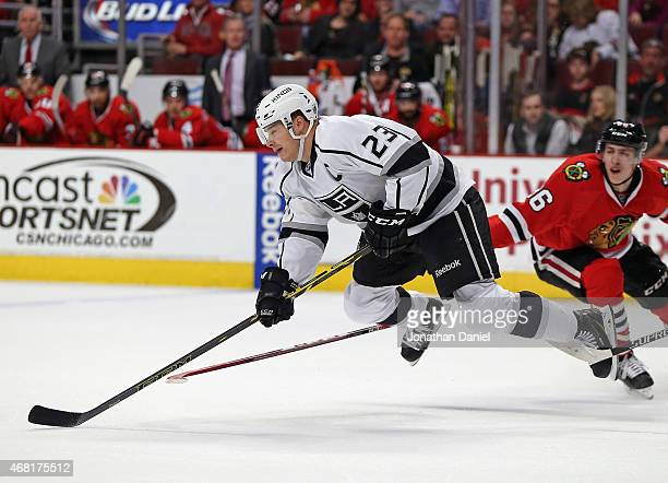 Dustin Brown of the Los Angeles Kings goes airbourne after being tripped against the Chicago Blackhawks at the United Center on March 30 2015 in...