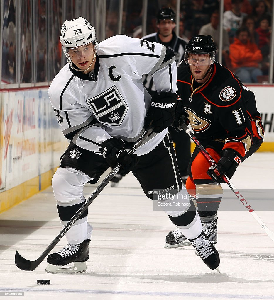 Dustin Brown #23 of the Los Angeles Kings handles the puck against Saku Koivu #11 of the Anaheim Ducks on February 2, 2013 at Honda Center in Anaheim, California.