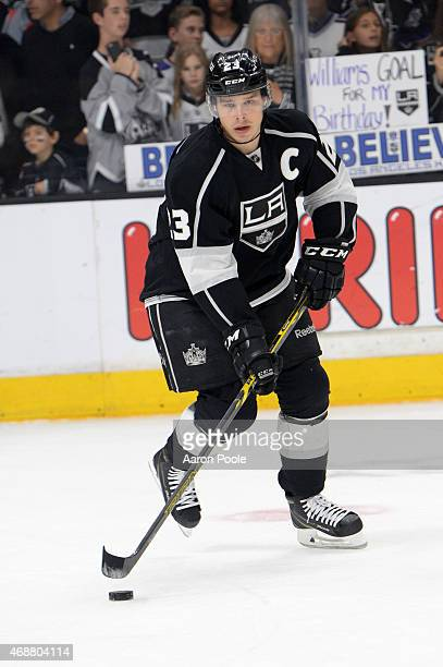 Dustin Brown of the Los Angeles Kings handles the puck before a game against the Colorado Avalanche at STAPLES Center on April 4 2015 in Los Angeles...