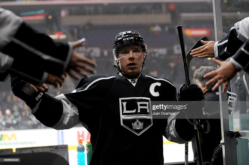 <a gi-track='captionPersonalityLinkClicked' href=/galleries/search?phrase=Dustin+Brown+-+Ice+Hockey+Player&family=editorial&specificpeople=4175092 ng-click='$event.stopPropagation()'>Dustin Brown</a> #23 of the Los Angeles Kings high-fives fans as he exits the ice before a game against the St. Louis Blues at STAPLES Center on December 18, 2014 in Los Angeles, California.