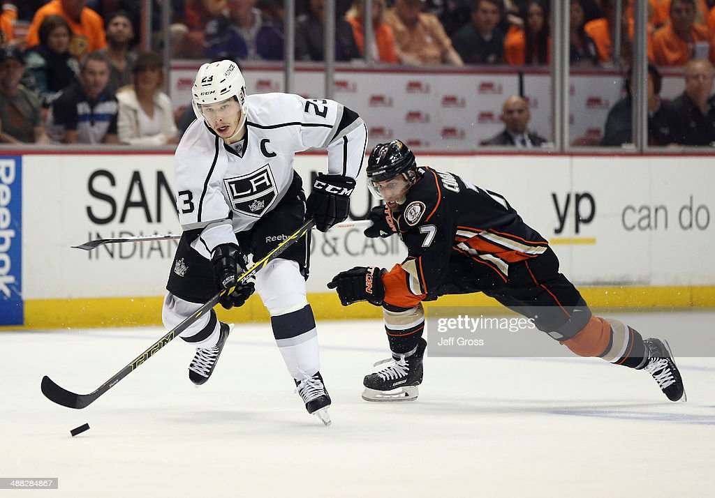 Dustin Brown #23 of the Los Angeles Kings is pursued by Andrew Cogliano #7 of the Anaheim Ducks for the puck in Game One of the Second Round of the 2014 NHL Stanley Cup Playoffs at Honda Center on May 3, 2014 in Anaheim, California.