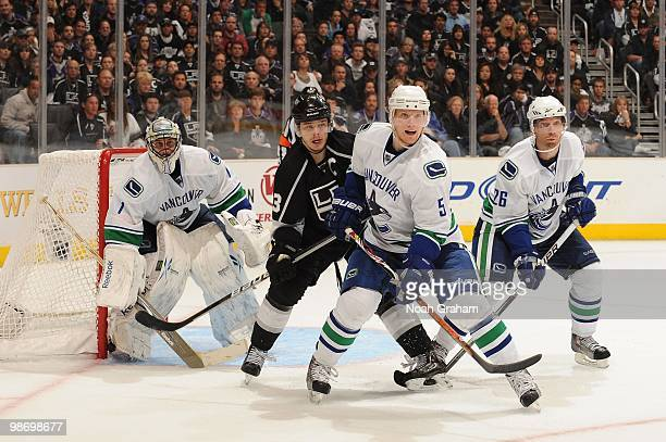 Dustin Brown of the Los Angeles Kings looks for the puck against Roberto Luongo Christian Ehrhoff and Mikael Samuelsson of the Vancouver Canucks in...