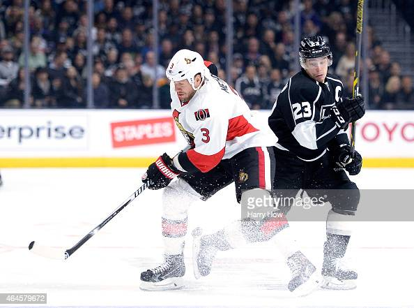 Dustin Brown of the Los Angeles Kings makes a move around Marc Methot of the Ottawa Senators during the second period at Staples Center on February...