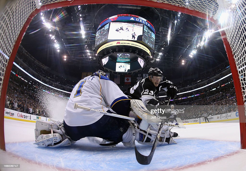 Dustin Brown #23 of the Los Angeles Kings misses a on a break away chance as goaltender Brian Elliott #1 of the St. Louis Blues defends in the second period of Game Six of the Western Conference Quarterfinals during the 2013 NHL Stanley Cup Playoffs at Staples Center on May 10, 2013 in Los Angeles, California. The Kings defeated the Blues 2-1.