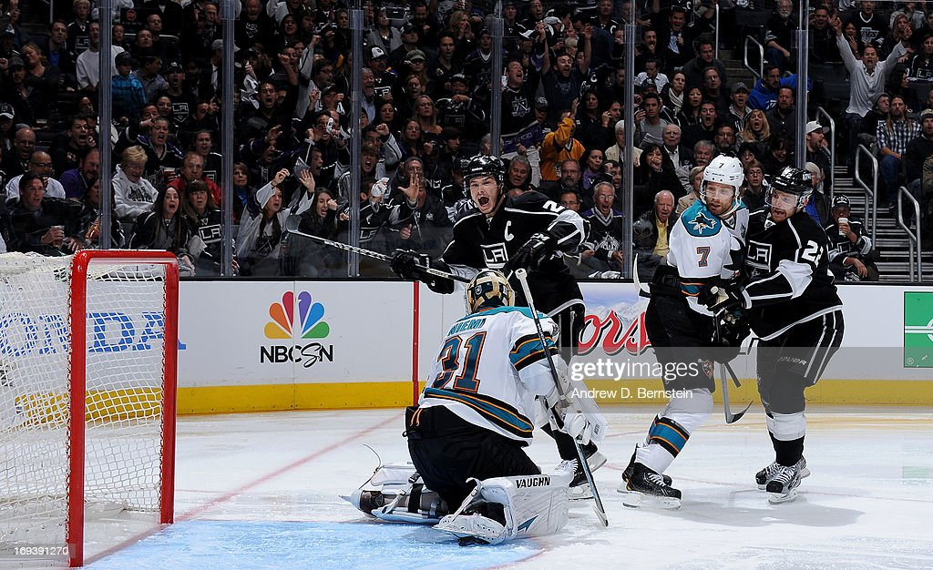 Dustin Brown #23 of the Los Angeles Kings reacts after a Kings goal against the San Jose Sharks in Game Five of the Western Conference Semifinals during the 2013 NHL Stanley Cup Playoffs at Staples Center on May 23, 2013 in Los Angeles, California.