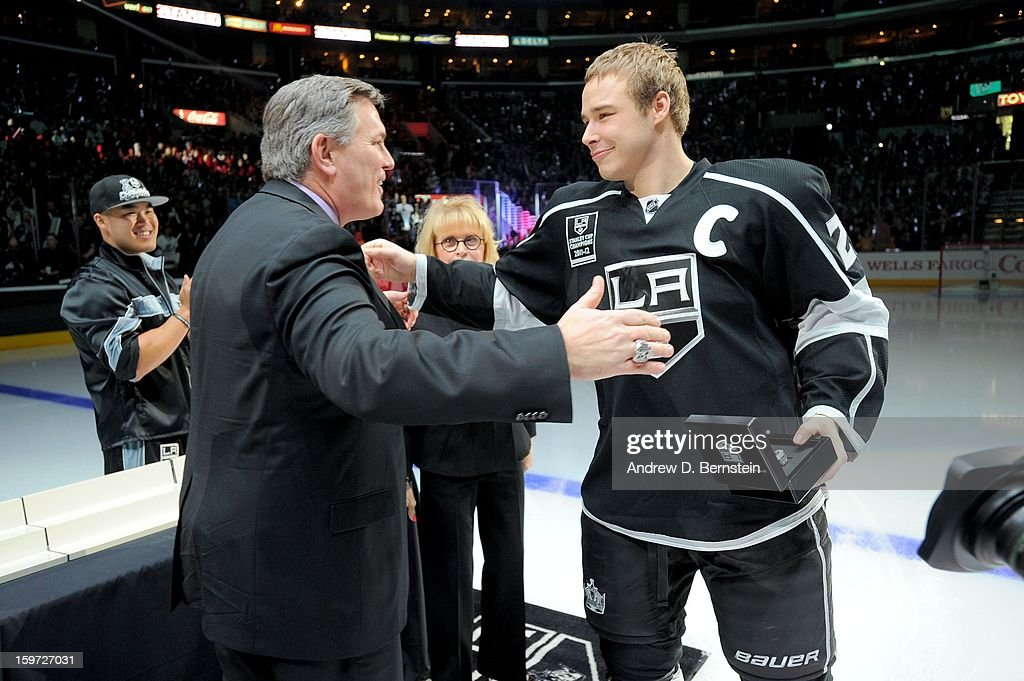 Dustin Brown #23 of the Los Angeles Kings receives his 2011-2012 Championship Ring prior to the game against the Chicago Blackhawks at Staples Center on January 19, 2013 in Los Angeles, California.