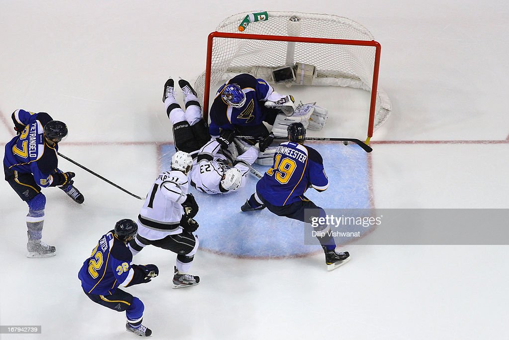 Dustin Brown #23 of the Los Angeles Kings runs into <a gi-track='captionPersonalityLinkClicked' href=/galleries/search?phrase=Brian+Elliott&family=editorial&specificpeople=687032 ng-click='$event.stopPropagation()'>Brian Elliott</a> #1 of the St. Louis Blues in Game Two of the Western Conference Quarterfinals during the 2013 NHL Stanley Cup Playoffs at the Scottrade Center on May 2, 2013 in St. Louis, Missouri. The Blues beat the Kings 2-1.