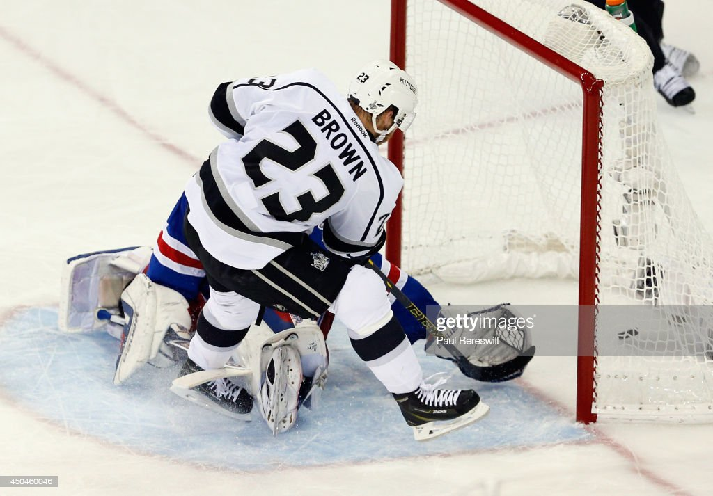 Dustin Brown #23 of the Los Angeles Kings scores a goal on Henrik Lundqvist #30 of the New York Rangers during the second period of Game Four of the 2014 NHL Stanley Cup Final at Madison Square Garden on June 11, 2014 in New York, New York.