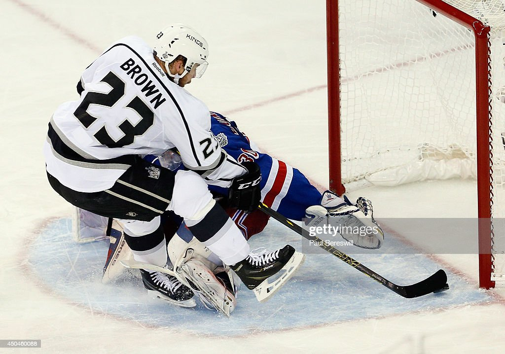 Dustin Brown #23 of the Los Angeles Kings scores on Henrik Lundqvist #30 of the New York Rangers during the second period of Game Four of the 2014 NHL Stanley Cup Final at Madison Square Garden on June 11, 2014 in New York, New York.