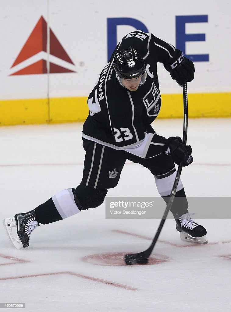 Dustin Brown #23 of the Los Angeles Kings shoots the puck during warm-up prior to the NHL game against the Tampa Bay Lightning at Staples Center on November 19, 2013 in Los Angeles, California. The Kings defeated the Lightning 5-2.