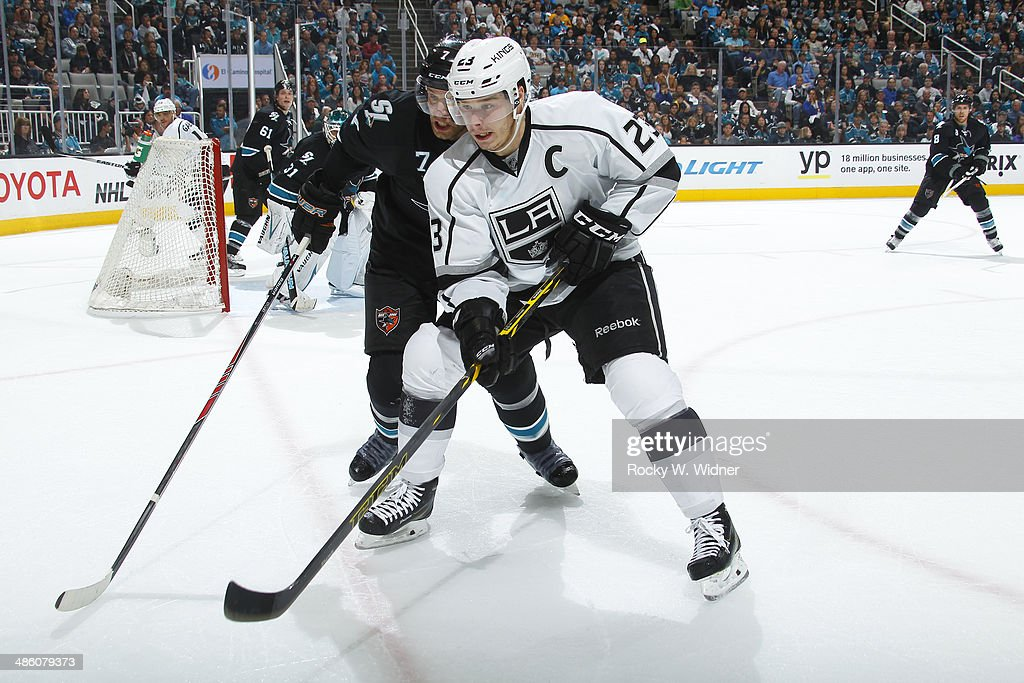 Dustin Brown #23 of the Los Angeles Kings skates against Brad Stuart #7 of the San Jose Sharks in Game Two of the First Round of the 2014 NHL Stanley Cup Playoffs at SAP Center on April 20, 2014 in San Jose, California.