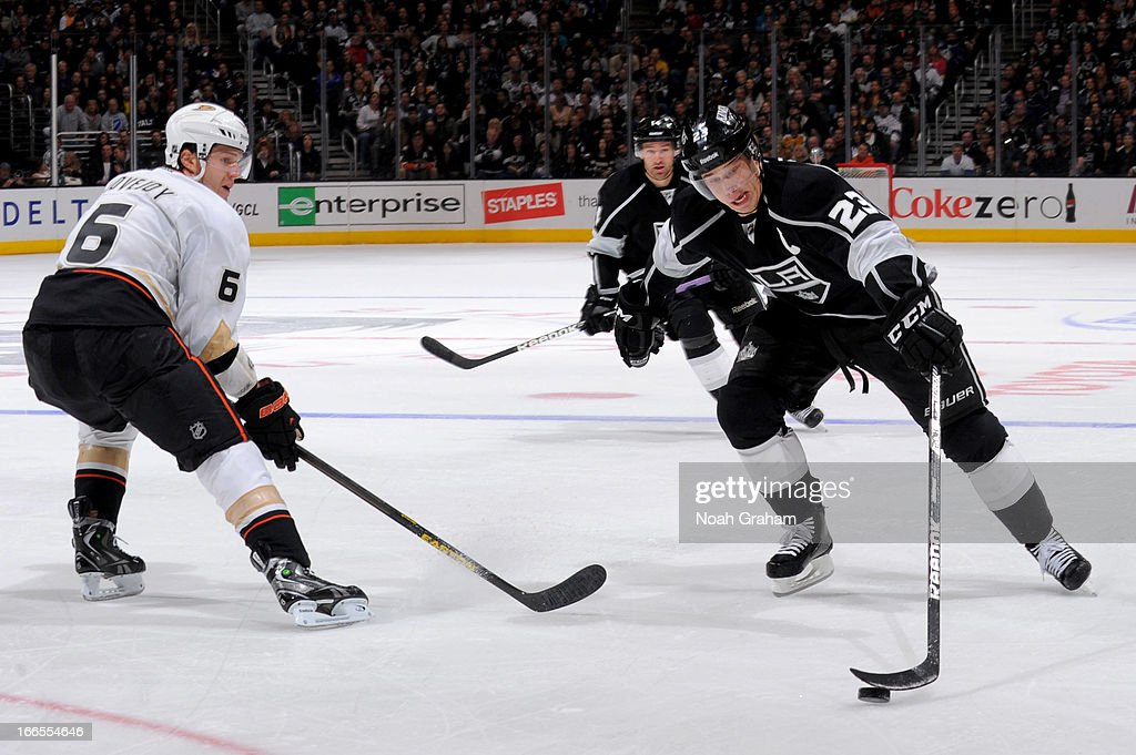 Dustin Brown #23 of the Los Angeles Kings skates with the puck against <a gi-track='captionPersonalityLinkClicked' href=/galleries/search?phrase=Ben+Lovejoy&family=editorial&specificpeople=4509565 ng-click='$event.stopPropagation()'>Ben Lovejoy</a> #6 of the Anaheim Ducks at Staples Center on April 13, 2013 in Los Angeles, California.