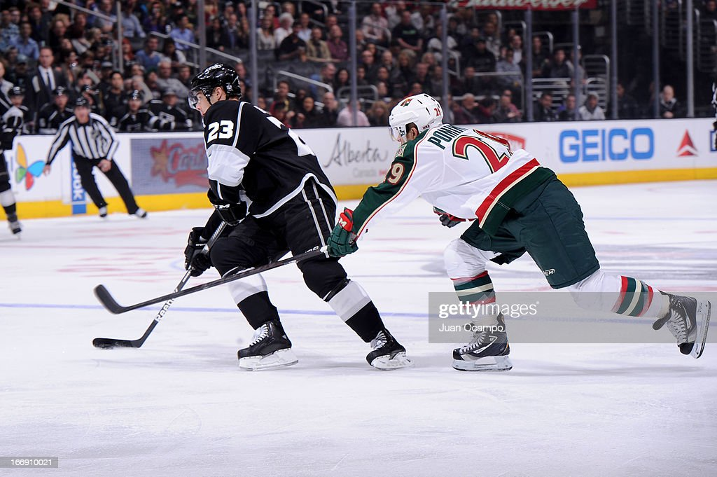 Dustin Brown #23 of the Los Angeles Kings skates with the puck against <a gi-track='captionPersonalityLinkClicked' href=/galleries/search?phrase=Jason+Pominville&family=editorial&specificpeople=570525 ng-click='$event.stopPropagation()'>Jason Pominville</a> #29 of the Minnesota Wild at Staples Center on April 4, 2013 in Los Angeles, California.