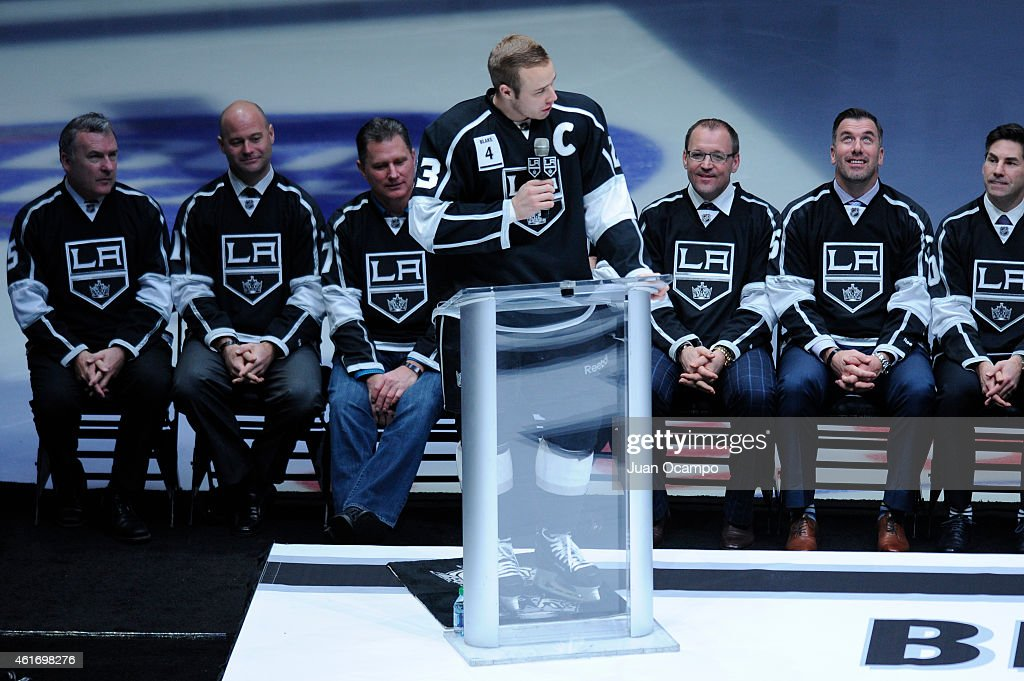 <a gi-track='captionPersonalityLinkClicked' href=/galleries/search?phrase=Dustin+Brown+-+Ice+Hockey+Player&family=editorial&specificpeople=4175092 ng-click='$event.stopPropagation()'>Dustin Brown</a> #23 of the Los Angeles Kings speaks during <a gi-track='captionPersonalityLinkClicked' href=/galleries/search?phrase=Rob+Blake+-+Ice+Hockey+Player&family=editorial&specificpeople=202891 ng-click='$event.stopPropagation()'>Rob Blake</a>'s jersey retirement ceremony before a game between the Los Angeles Kings and the Anaheim Ducks at STAPLES Center on January 17, 2015 in Los Angeles, California.