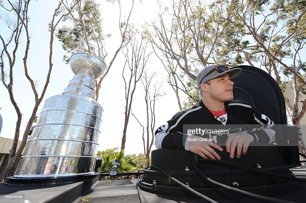 Dustin Brown #23 of the Los Angeles Kings stands proudly next to the Stanley Cup during the Los Angeles Kings South Bay Victory Parade on June 18, 2014 in Redondo Beach, California.