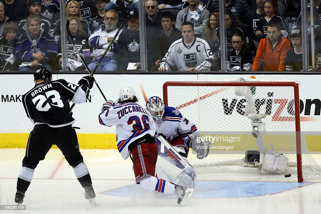 Dustin Brown #23 of the Los Angeles Kings takes a shot against goaltender Henrik Lundqvist #30 of the New York Rangers in double overtime during Game Two of the 2014 NHL Stanley Cup Final at the Staples Center on June 7, 2014 in Los Angeles, California.
