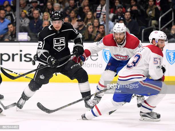 Dustin Brown of the Los Angeles Kings watches the puck with Shea Weber and Victor Mete of the Montreal Canadiens during the second period at Staples...