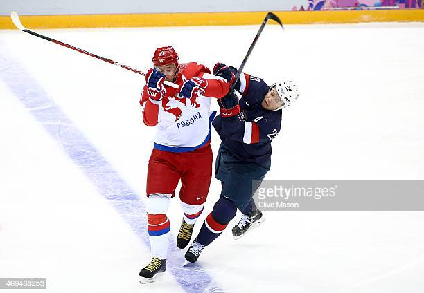 Dustin Brown of United States and Ilya Kovalchuk fight for position of Russia during the Men's Ice Hockey Preliminary Round Group A game on day eight...