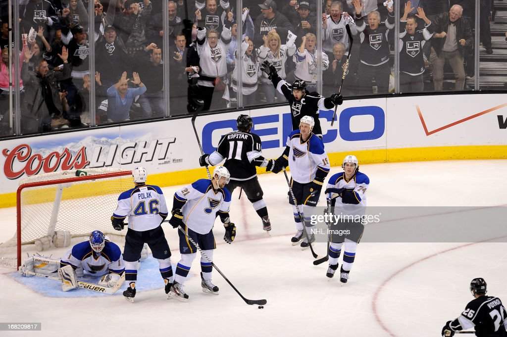 Dustin Brown#23 and <a gi-track='captionPersonalityLinkClicked' href=/galleries/search?phrase=Anze+Kopitar&family=editorial&specificpeople=634911 ng-click='$event.stopPropagation()'>Anze Kopitar</a> #11 of the Los Angeles Kings celebrate a goal against the St. Louis Blues in Game Four of the Western Conference Quarterfinals during the 2013 NHL Stanley Cup Playoffs at Staples Center on May 6, 2013 in Los Angeles, California.