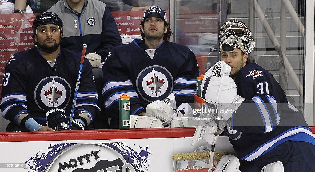 <a gi-track='captionPersonalityLinkClicked' href=/galleries/search?phrase=Dustin+Byfuglien&family=editorial&specificpeople=672505 ng-click='$event.stopPropagation()'>Dustin Byfuglien</a> #33, <a gi-track='captionPersonalityLinkClicked' href=/galleries/search?phrase=Al+Montoya&family=editorial&specificpeople=213916 ng-click='$event.stopPropagation()'>Al Montoya</a> #35 and Ondrej Pavelec #31 pause for a break in play in a game against theMontreal Canadiens during third period NHL action on April 25, 2013 at the MTS Centre in Winnipeg, Manitoba, Canada.