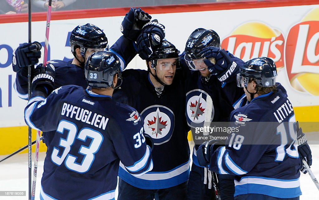 <a gi-track='captionPersonalityLinkClicked' href=/galleries/search?phrase=Dustin+Byfuglien&family=editorial&specificpeople=672505 ng-click='$event.stopPropagation()'>Dustin Byfuglien</a> #33, <a gi-track='captionPersonalityLinkClicked' href=/galleries/search?phrase=Andrew+Ladd&family=editorial&specificpeople=228452 ng-click='$event.stopPropagation()'>Andrew Ladd</a> #16, <a gi-track='captionPersonalityLinkClicked' href=/galleries/search?phrase=Grant+Clitsome&family=editorial&specificpeople=4596638 ng-click='$event.stopPropagation()'>Grant Clitsome</a> #24, <a gi-track='captionPersonalityLinkClicked' href=/galleries/search?phrase=Blake+Wheeler&family=editorial&specificpeople=716703 ng-click='$event.stopPropagation()'>Blake Wheeler</a> #26 and <a gi-track='captionPersonalityLinkClicked' href=/galleries/search?phrase=Bryan+Little&family=editorial&specificpeople=540533 ng-click='$event.stopPropagation()'>Bryan Little</a> #18 of the Winnipeg Jets celebrate a second period goal against the San Jose Sharks at the MTS Centre on November 10, 2013 in Winnipeg, Manitoba, Canada.