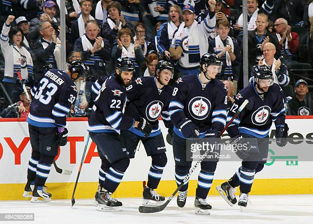 Dustin Byfuglien Chris Thorburn Andrew Copp Jacob Trouba and Drew Stafford of the Winnipeg Jets skate to the bench after celebrating Stafford's...