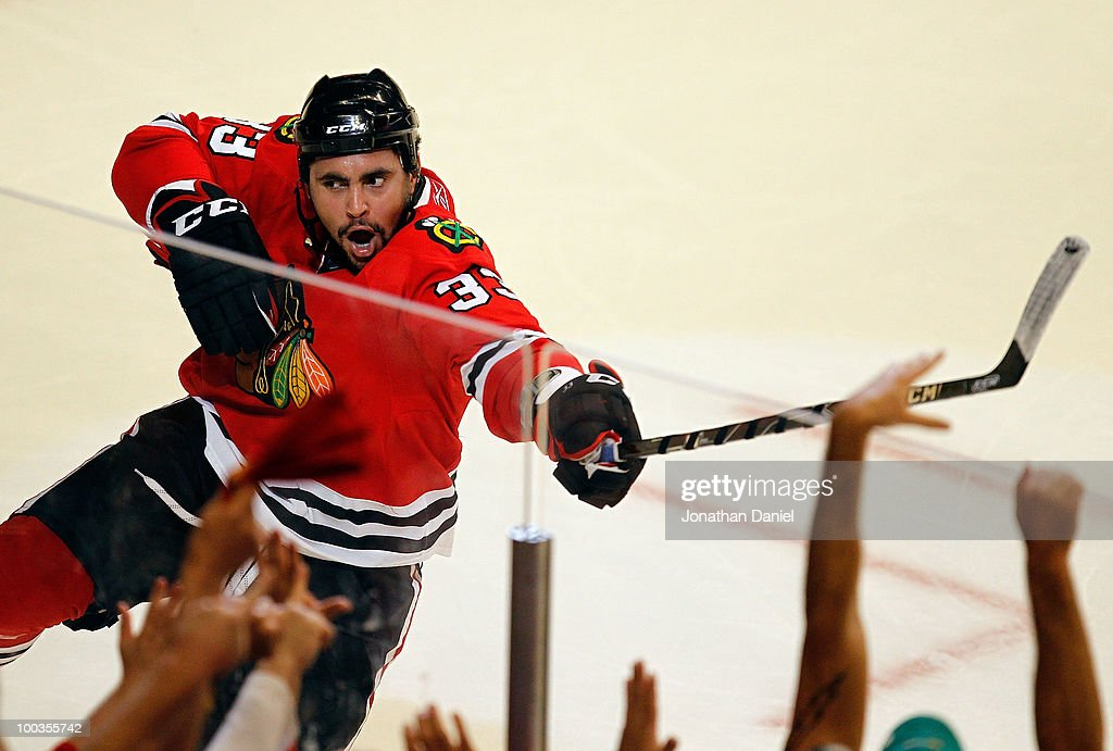 Dustin Byfuglien #33 of the Chicago Blackhawks celebrates his third period goal while taking on the San Jose Sharks in Game Four of the Western Conference Finals during the 2010 NHL Stanley Cup Playoffs at the United Center on May 23, 2010 in Chicago, Illinois.