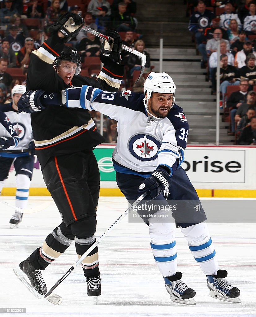 <a gi-track='captionPersonalityLinkClicked' href=/galleries/search?phrase=Dustin+Byfuglien&family=editorial&specificpeople=672505 ng-click='$event.stopPropagation()'>Dustin Byfuglien</a> #33 of the Winnipeg Jets battles for position against <a gi-track='captionPersonalityLinkClicked' href=/galleries/search?phrase=Hampus+Lindholm&family=editorial&specificpeople=8630299 ng-click='$event.stopPropagation()'>Hampus Lindholm</a> #47 of the Anaheim Ducks on March 31, 2014 at Honda Center in Anaheim, California.