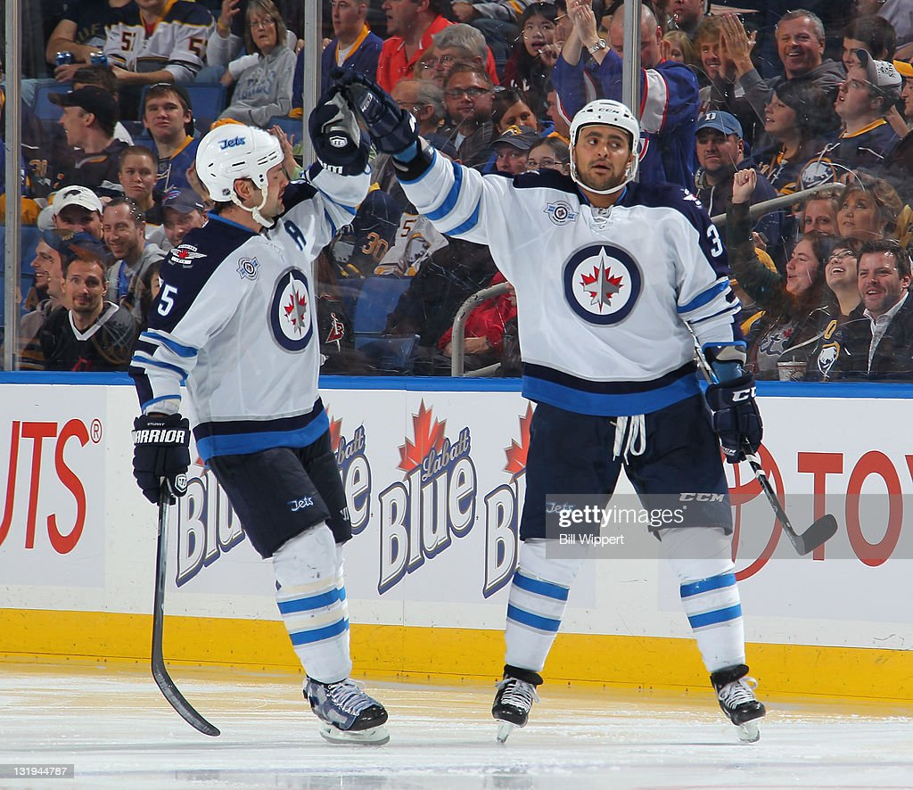 <a gi-track='captionPersonalityLinkClicked' href=/galleries/search?phrase=Dustin+Byfuglien&family=editorial&specificpeople=672505 ng-click='$event.stopPropagation()'>Dustin Byfuglien</a> #33 of the Winnipeg Jets celebrates his third period goal with Mark Stuart #5 against the Buffalo Sabres at First Niagara Center on November 8, 2011 in Buffalo, New York.