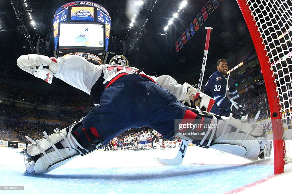 Dustin Byfuglien of the Winnipeg Jets competes against Cory Schneider of the New Jersey Devils in the Discover NHL Shootout during the 2016 Honda NHL...