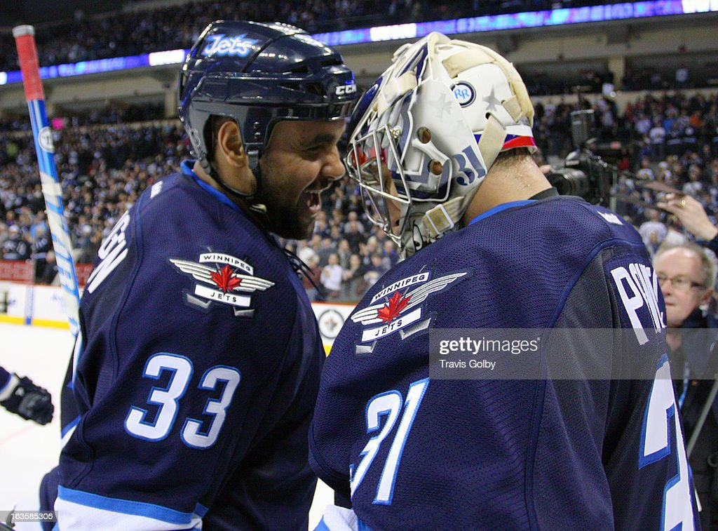 <a gi-track='captionPersonalityLinkClicked' href=/galleries/search?phrase=Dustin+Byfuglien&family=editorial&specificpeople=672505 ng-click='$event.stopPropagation()'>Dustin Byfuglien</a> #33 of the Winnipeg Jets congratulates goaltender Ondrej Pavelec #31 following a 5-2 victory over the Toronto Maple Leafs at the MTS Centre on March 12, 2013 in Winnipeg, Manitoba, Canada.