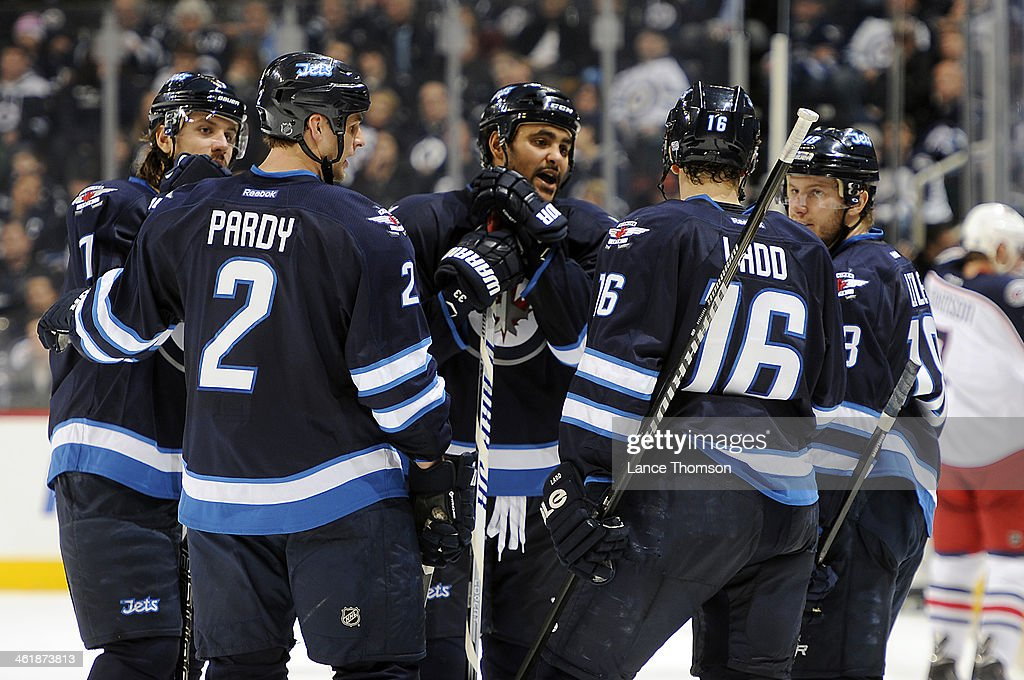 <a gi-track='captionPersonalityLinkClicked' href=/galleries/search?phrase=Dustin+Byfuglien&family=editorial&specificpeople=672505 ng-click='$event.stopPropagation()'>Dustin Byfuglien</a> #33 of the Winnipeg Jets discusses strategy with teammtes <a gi-track='captionPersonalityLinkClicked' href=/galleries/search?phrase=Keaton+Ellerby&family=editorial&specificpeople=4111546 ng-click='$event.stopPropagation()'>Keaton Ellerby</a> #7, <a gi-track='captionPersonalityLinkClicked' href=/galleries/search?phrase=Adam+Pardy&family=editorial&specificpeople=2221762 ng-click='$event.stopPropagation()'>Adam Pardy</a> #2, <a gi-track='captionPersonalityLinkClicked' href=/galleries/search?phrase=Andrew+Ladd&family=editorial&specificpeople=228452 ng-click='$event.stopPropagation()'>Andrew Ladd</a> #16 and <a gi-track='captionPersonalityLinkClicked' href=/galleries/search?phrase=Bryan+Little&family=editorial&specificpeople=540533 ng-click='$event.stopPropagation()'>Bryan Little</a> #18 during a third period stoppage in play against the Columbus Blue Jackets at the MTS Centre on January 11, 2014 in Winnipeg, Manitoba, Canada.