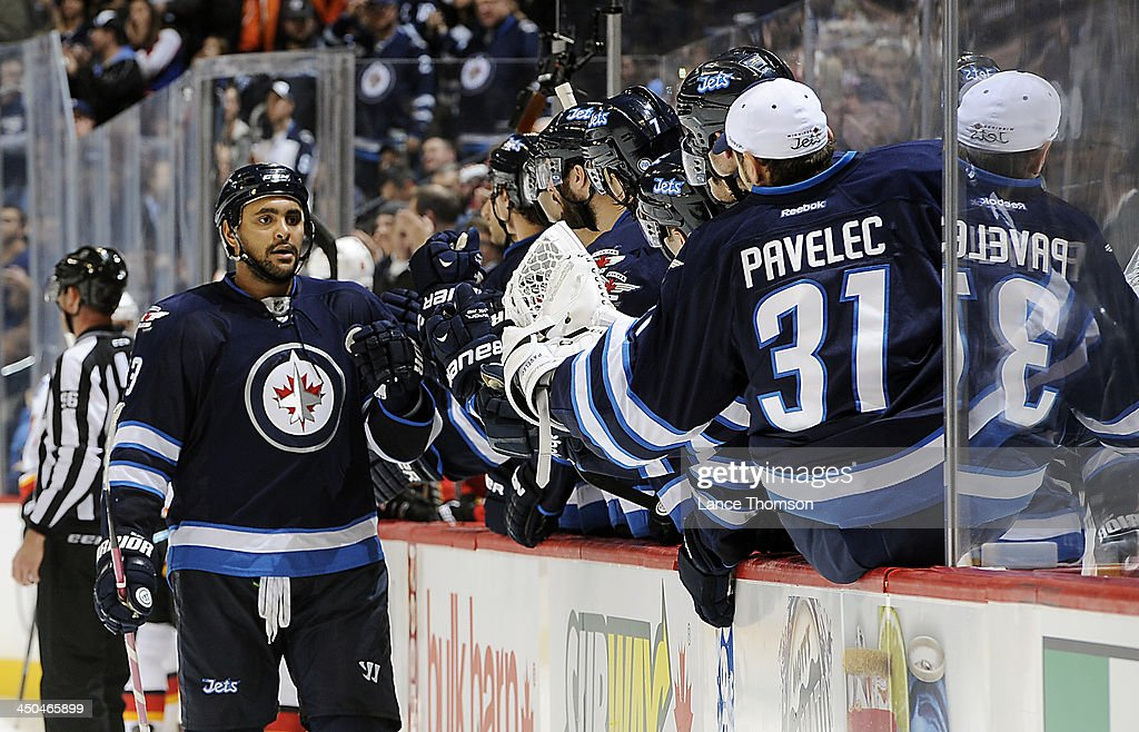 <a gi-track='captionPersonalityLinkClicked' href=/galleries/search?phrase=Dustin+Byfuglien&family=editorial&specificpeople=672505 ng-click='$event.stopPropagation()'>Dustin Byfuglien</a> #33 of the Winnipeg Jets gets congratulated by teammates at the bench after scoring a third period goal against the Calgary Flames at the MTS Centre on November 18, 2013 in Winnipeg, Manitoba, Canada.