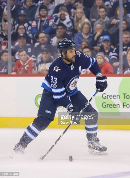 Dustin Byfuglien of the Winnipeg Jets gets set to pass the puck up the ice during first period action against the Ottawa Senators at the Bell MTS...