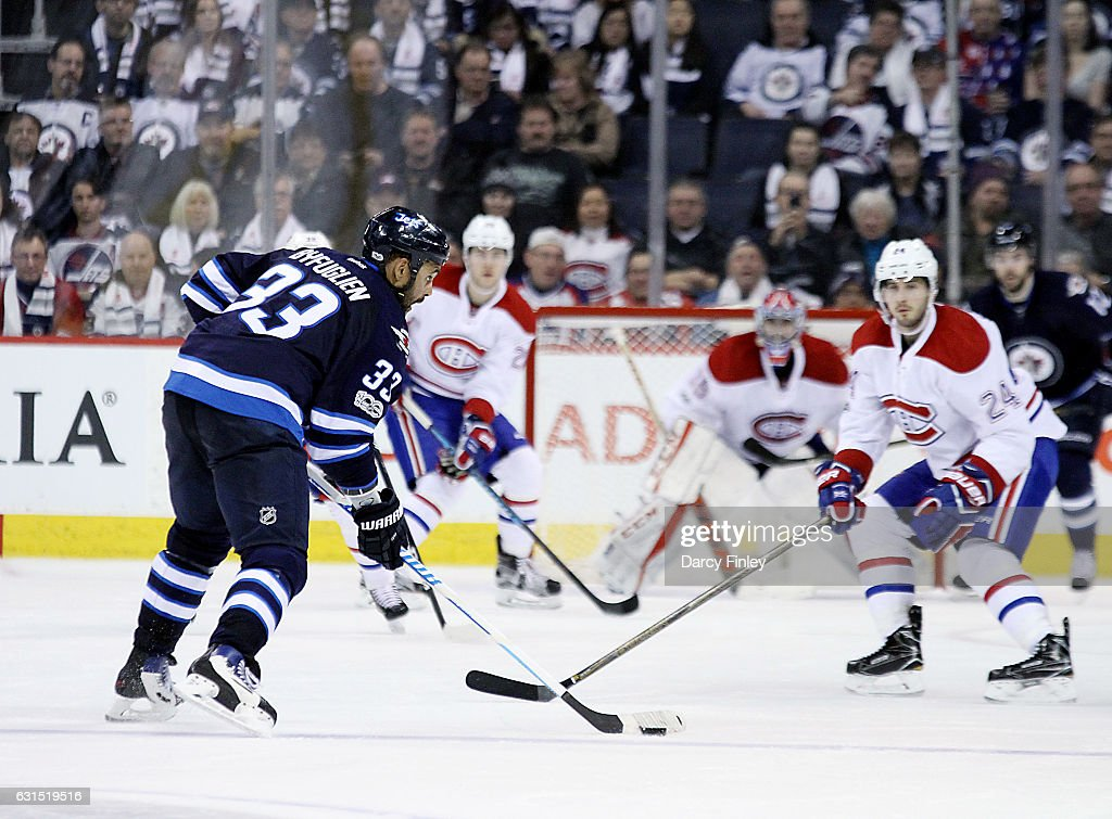 Dustin Byfuglien #33 of the Winnipeg Jets gets set to shoot the puck from the point during third period action against the Montreal Canadiens at the MTS Centre on January 11, 2017 in Winnipeg, Manitoba, Canada.